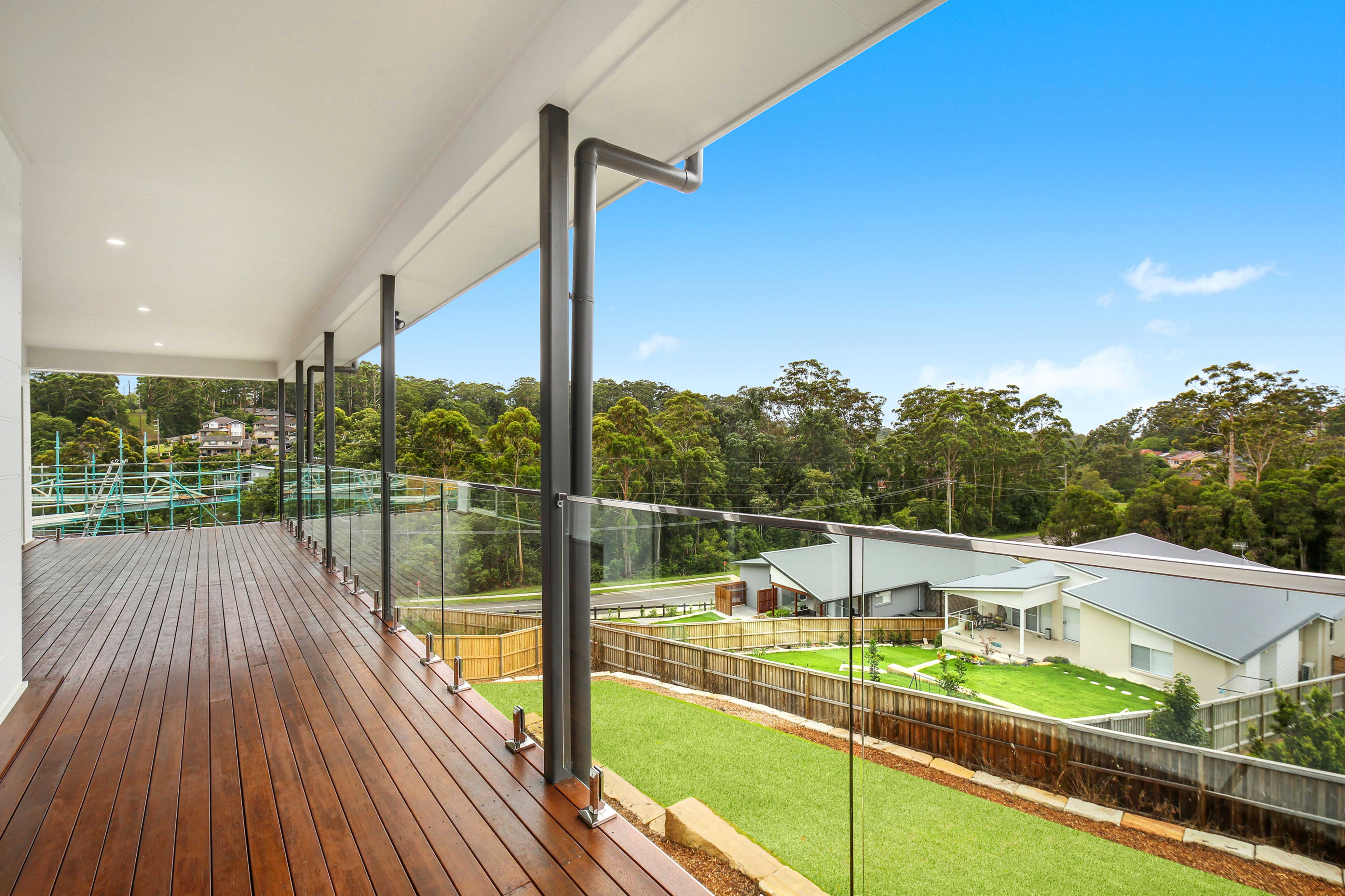 Frameless glass balustrades fixed to merbau timber deck