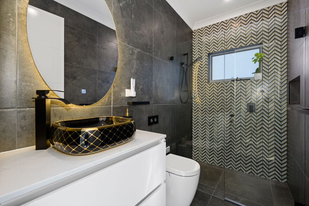 Feature Wall Mosaic Tile and statement vanity basin