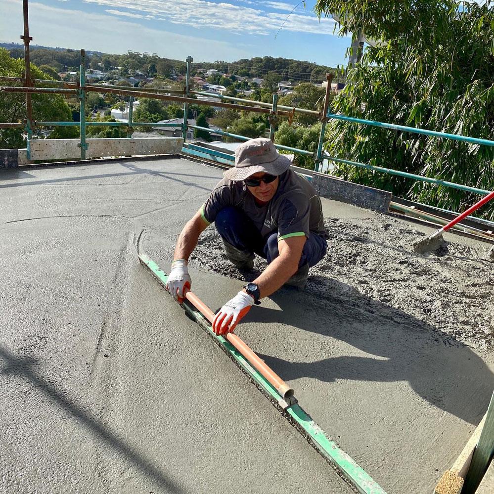 Screeding concrete suspended slab