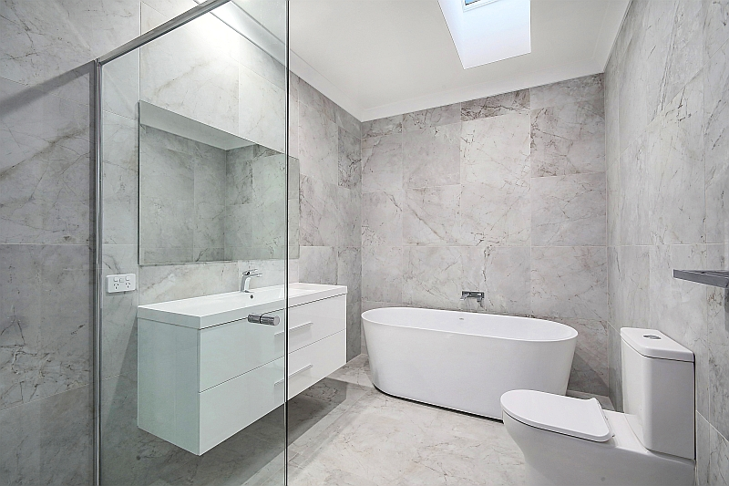 Floor to Ceiling Marble Tiling with Freestanding Bath
