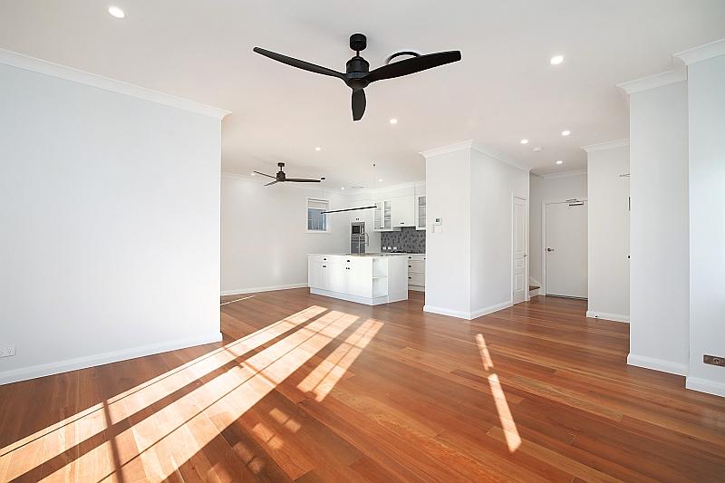 Light filled living space with Blackbutt flooring