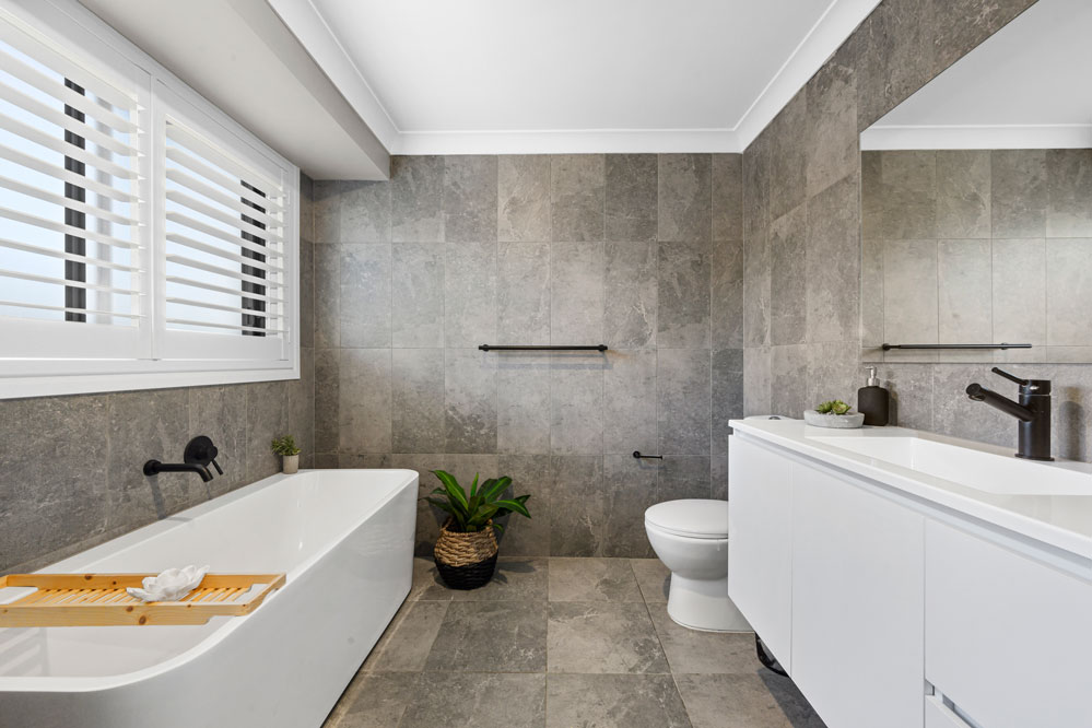 Ceiling Height Wall Tiles with Freestanding Bath
