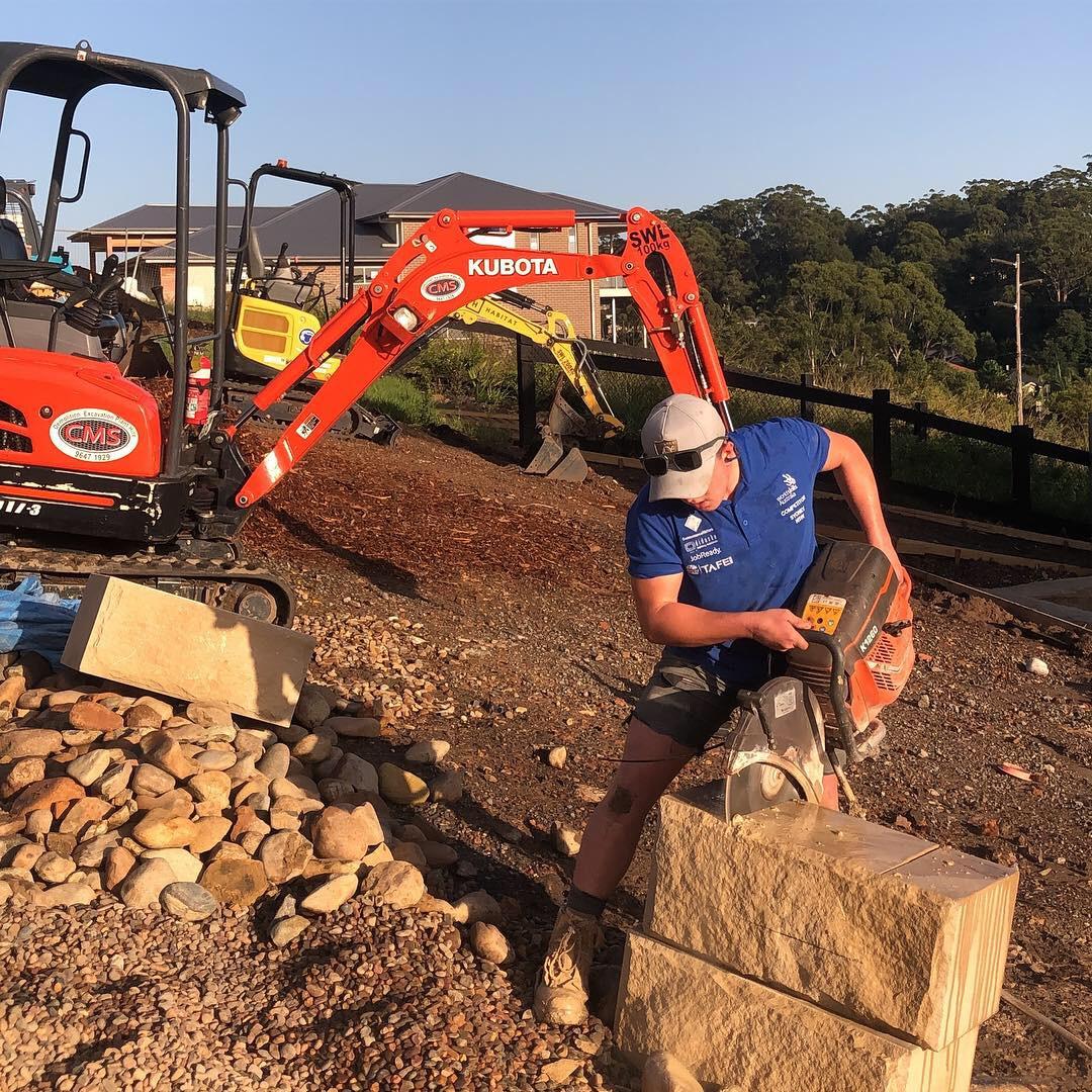 Diamond saw cutting through sandstone blocks