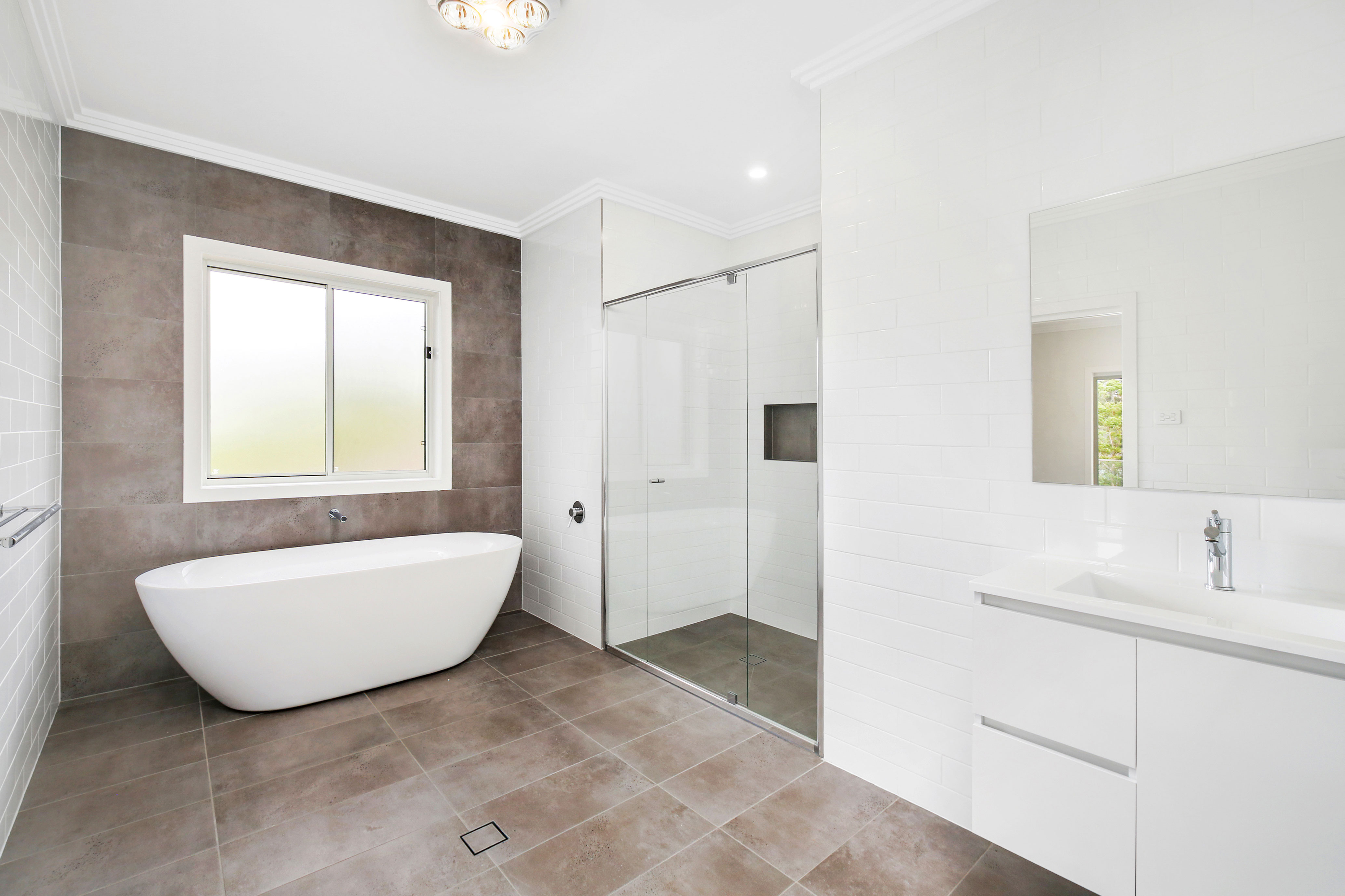 Spacious Ensuite with porcelain floor to ceiling wall tiles