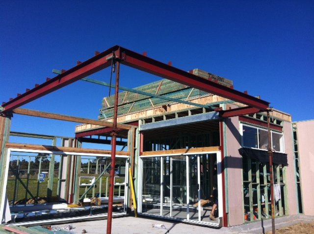 Structural steel beams over a covered alfresco gallery for Structural beams for houses